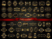 Large collection of dark gold-framed labels in vintage style Royalty Free Stock Photos