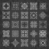 Large collection of decorative calligraphic ornaments in vintage style on a chalkboard background Stock Photos