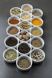 Large collection of different spices and herbs isolated on Black Stock Photos