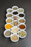 Large collection of different spices and herbs isolated on Black Stock Photography