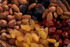 Large collection of nuts, seeds and dried fruits in brown wooden bowls Stock Images