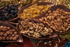 Large collection of nuts, seeds and dried fruits in brown wooden bowls Royalty Free Stock Photos