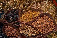 Large collection of nuts, seeds and dried fruits in brown wooden bowls Royalty Free Stock Images