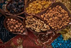 Large collection of nuts, seeds and dried fruits in brown wooden bowls Royalty Free Stock Image
