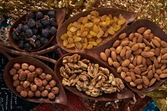 Large collection of nuts, seeds and dried fruits in brown wooden bowls Stock Photo