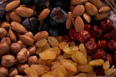 Large collection of nuts, seeds and dried fruits in brown wooden bowls Royalty Free Stock Photo