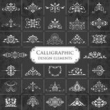 Large collection of ornate calligraphic design elements on a chalkboard background - vector set Royalty Free Stock Photography