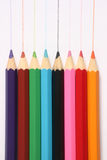 Large colored pencils. With pencil marks on white paper Royalty Free Stock Photo