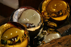 Large colored spheres decorated gold and silver Stock Images