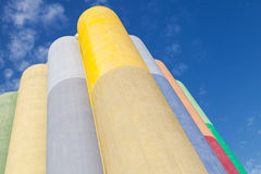 Large colorful concrete tanks for storage of bulk materials Royalty Free Stock Photography