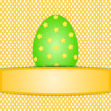 Large colorful green easter egg on easter egg pattern Royalty Free Stock Photo
