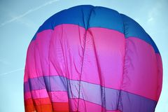 Large colorful hot air balloon is flying in the sky Stock Images