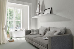 Large comfortable grey upholstered sofa Stock Photos
