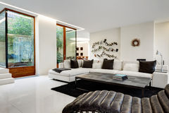 Large and comfortable living room with a white sofa. In a luxurious mansion with a winter garden Stock Photo