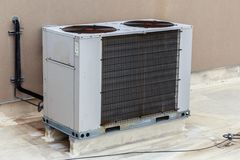 Large Commercial Air Conditioning Unit. On a concrete support base stock photos