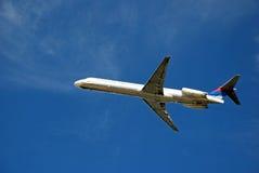 Large Commercial Airliner. A large passenger jet begins its ascent Stock Image