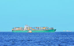 Commercial ship. A cargo ship is filled to the top of the load Royalty Free Stock Image