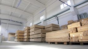 Large commercial warehouse with plywood sun. Dolly shot stock video