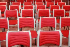 Empty red seats. A large concert hall full of emty red seats Royalty Free Stock Photography