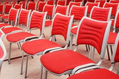 Empty red seats. A large concert hall full of emty red seats Stock Photo