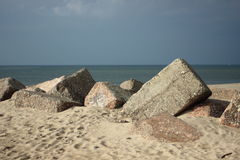 Large concrete blocks on a beach used for a groyne Stock Photo