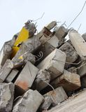 Large concrete chunks with twisted metal on a demolition site Royalty Free Stock Photos