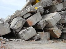 Large concrete chunks with twisted metal on a demolition site Stock Image