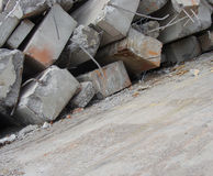 Large concrete chunks with twisted metal and industrial building Royalty Free Stock Photography