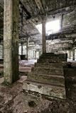 Large concrete steps within the abandoned factory hall. Large concrete steps within the abandoned and devastated factory hall royalty free stock images