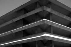 Large concrete structure. Corner of a large concrete cooling and air vent system, shown at an angle in black and white Stock Images
