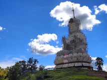 Large constructing respect statue under blue sky. Guan yin constructing grand statue in Chinese-styled in Thailand under blue sky Royalty Free Stock Image