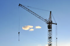 Large construction crane against the blue sky. Silhouette Stock Photography