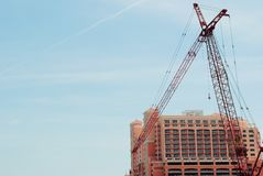 Large Construction Crane and Tall Building Royalty Free Stock Image