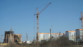 Large construction cranes work at the building stock video footage