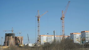 Large construction cranes work at the building stock video
