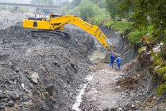 Large construction shovel. A view of a large construction shovel working along a deep ditch that used to be a riverbed stock photos