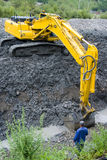 Large construction shovel. A view of a large construction shovel working on a deep ditch at a construction site stock image