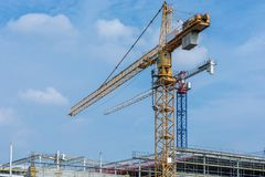 Large construction site with cranes during the construction of the shell stock image