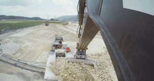 Large construction site with trucks and heavy tools stock footage
