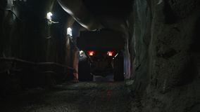 Large construction trucks working inside a tunnel. Work site stock video