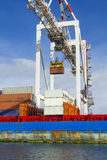 Large container crane lifting a container at Swanson Dock in the Port of Melbourne Royalty Free Stock Photo