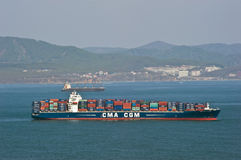 Large container ship CMA CGM Tarpon loaded at anchor in the roads. Nakhodka Bay. East (Japan) Sea. 13.05.2014 Royalty Free Stock Image