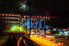 Large container ship at the Container Terminal Altenwerder in Hamburg at night Royalty Free Stock Photos