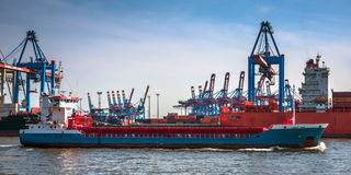 Large container ship and a container terminal Stock Photos