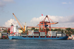 Large container ship in a dock at port - Side view Stock Image