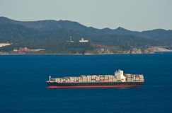 Large container ship loaded at anchor in the roads. Nakhodka Bay. East (Japan) Sea. 17.09.2014 Royalty Free Stock Photo