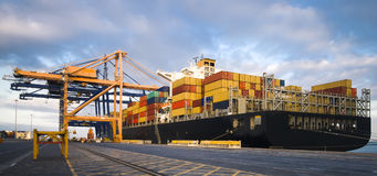 Large container ship moored in port during cargo operation Royalty Free Stock Image