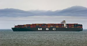 Large container ship MSC Madeleine loaded at anchor in the roads. Nakhodka Bay. East (Japan) Sea. 20.05.2014 Royalty Free Stock Image