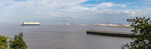 Large container ship passing Portishead into Portbury Docks, Bristol royalty free stock image