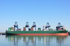 Large Container Ship in port with cranes Royalty Free Stock Image